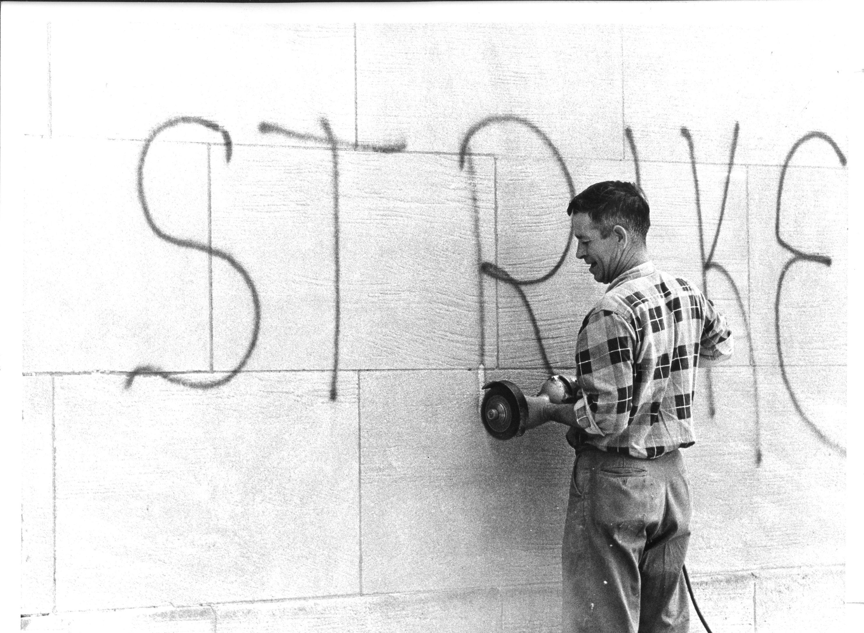"Employee cleaning ""Strike"" graffiti"