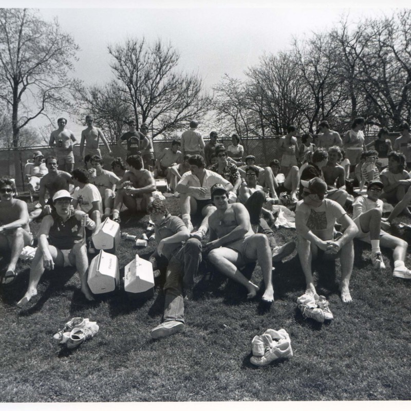 Male students out on a lawn