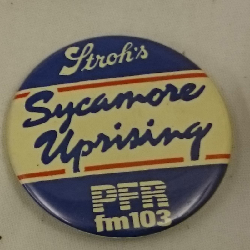 """Sycamore Uprising"" button"