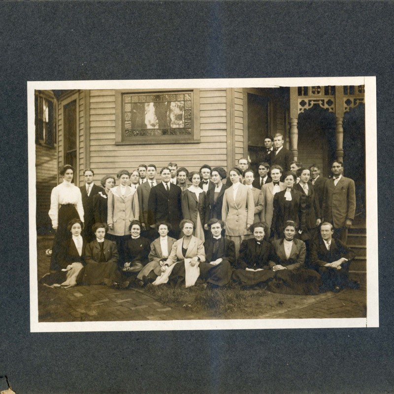 Students standing outside a house