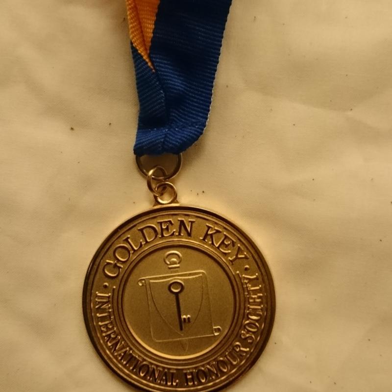 [Gold Key medal]