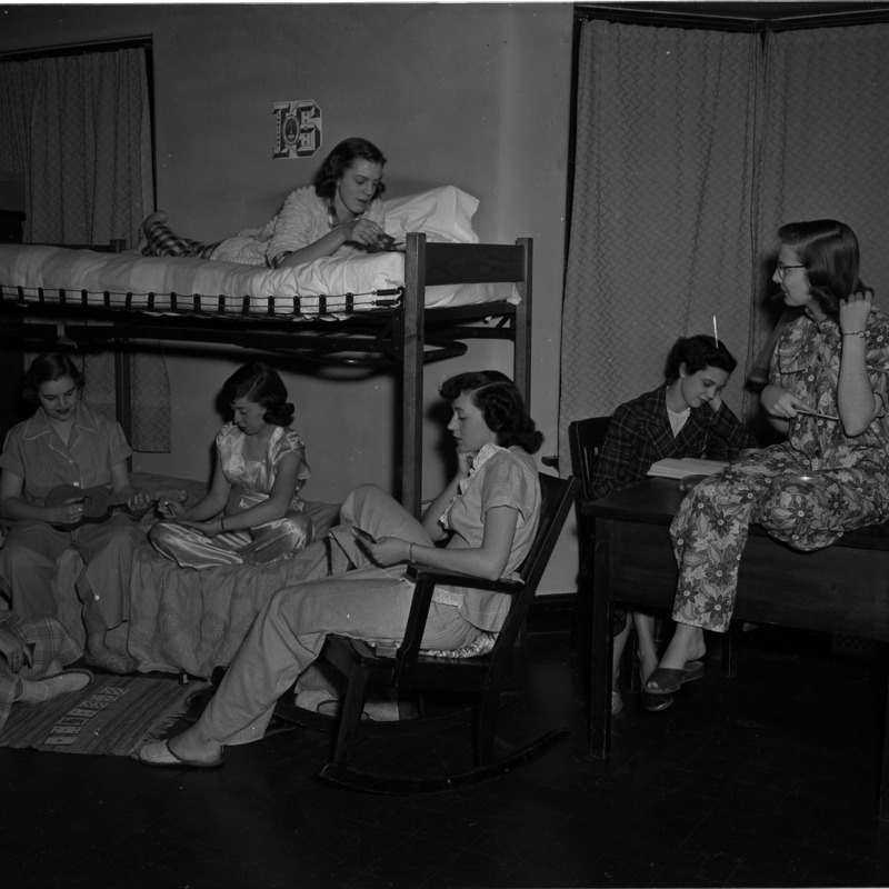 Students in pajamas in a Reeve Residence Hall room