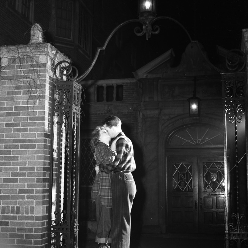 Couple kissing in front of Reeve Residence Hall