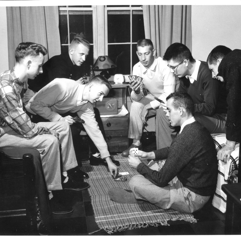 Students playing cards in Residence Hall room