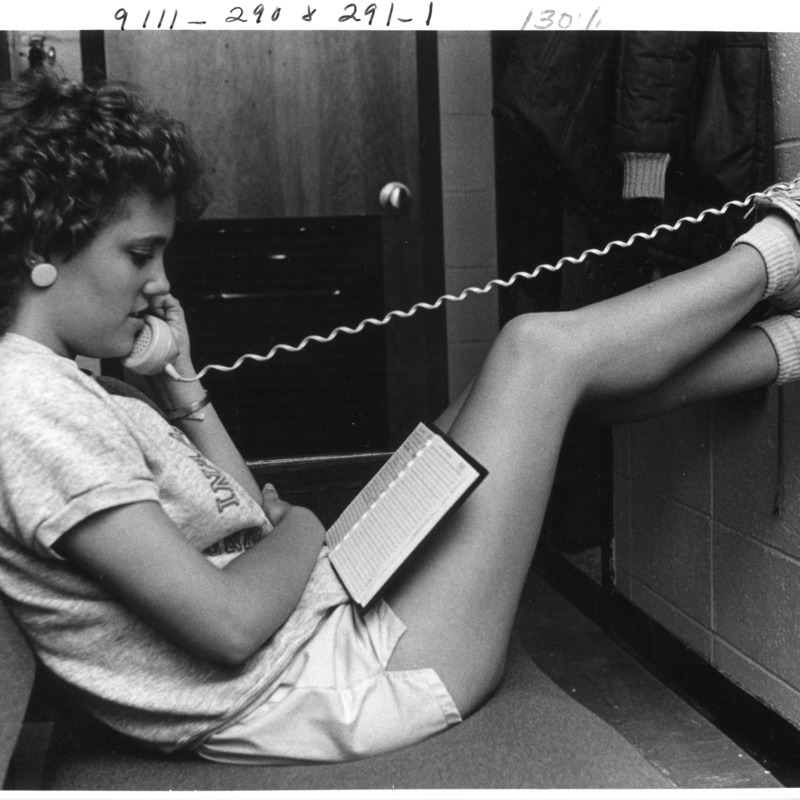 Student talking on phone in dorm room