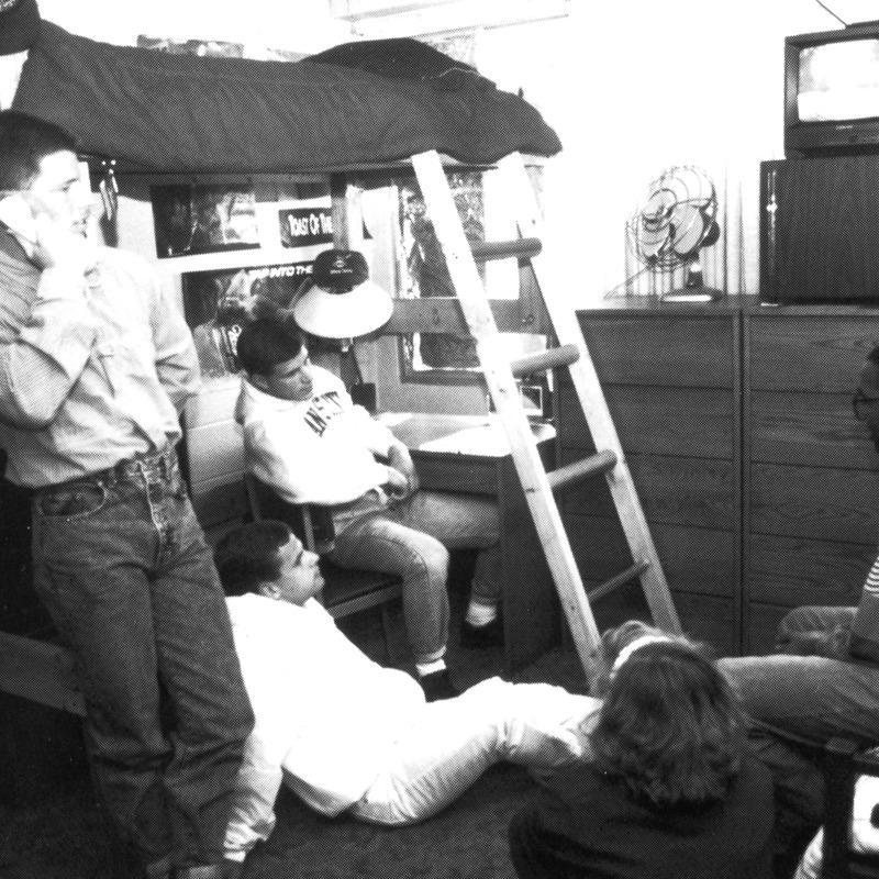 Students watching TV in dorm room
