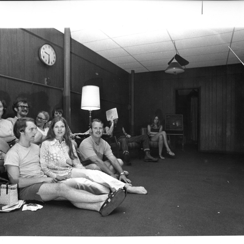 Group of students watching TV in Residence Hall lounge